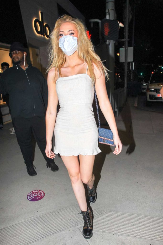 Saxon Sharbino in a White Mini Dress