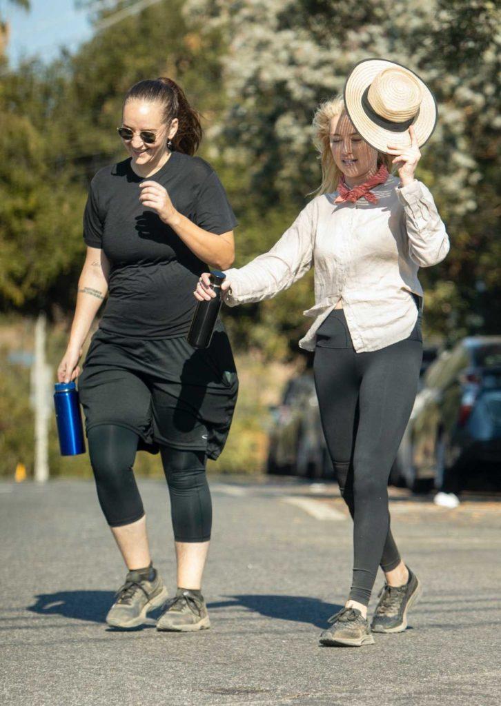Amber Heard in a Black Leggings