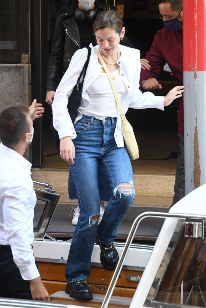 Emma Corrin in a Ripped Jeans