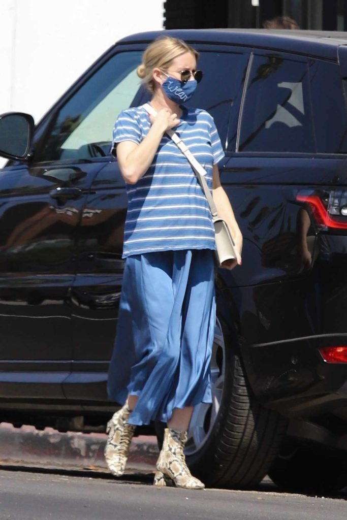 Emma Roberts in a Blue Striped Tee