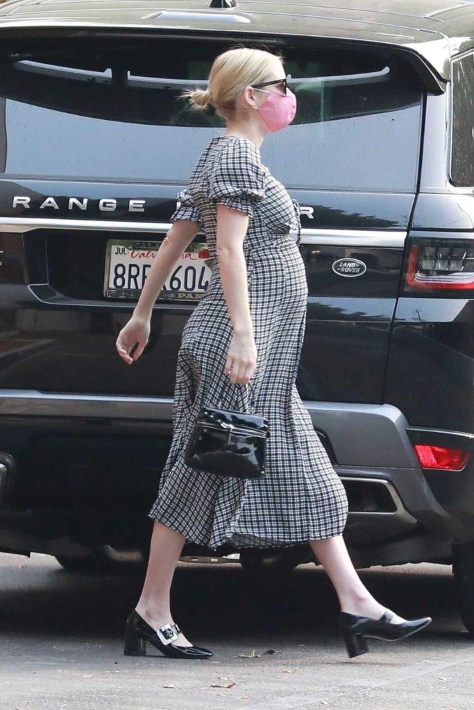 Emma Roberts in a Grey Dress