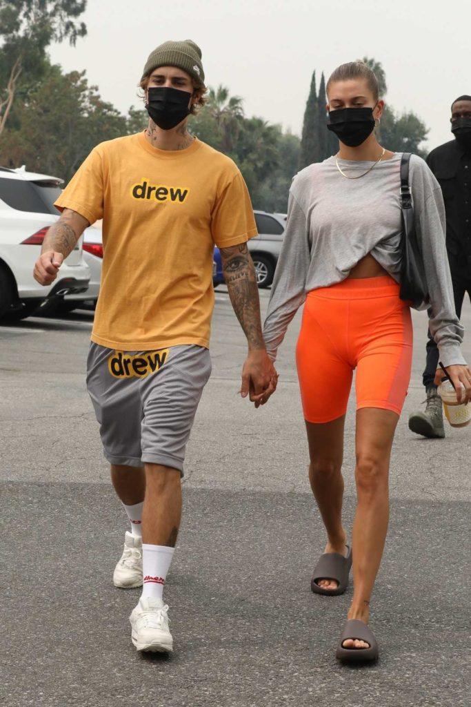 Hailey Bieber in an Orange Spandex Shorts