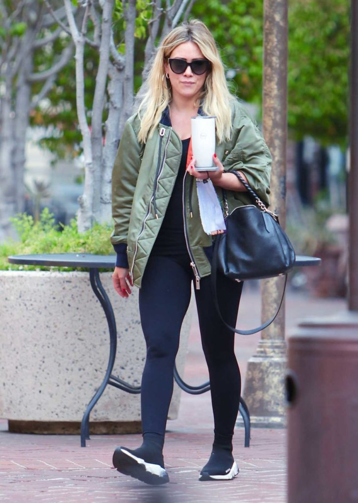 Hilary Duff in a Green Bomber Jacket