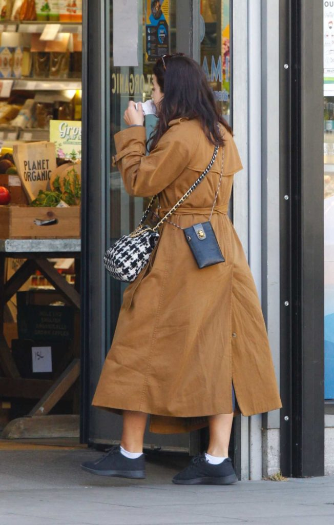 Jenna Coleman in a Tan Trench Coat