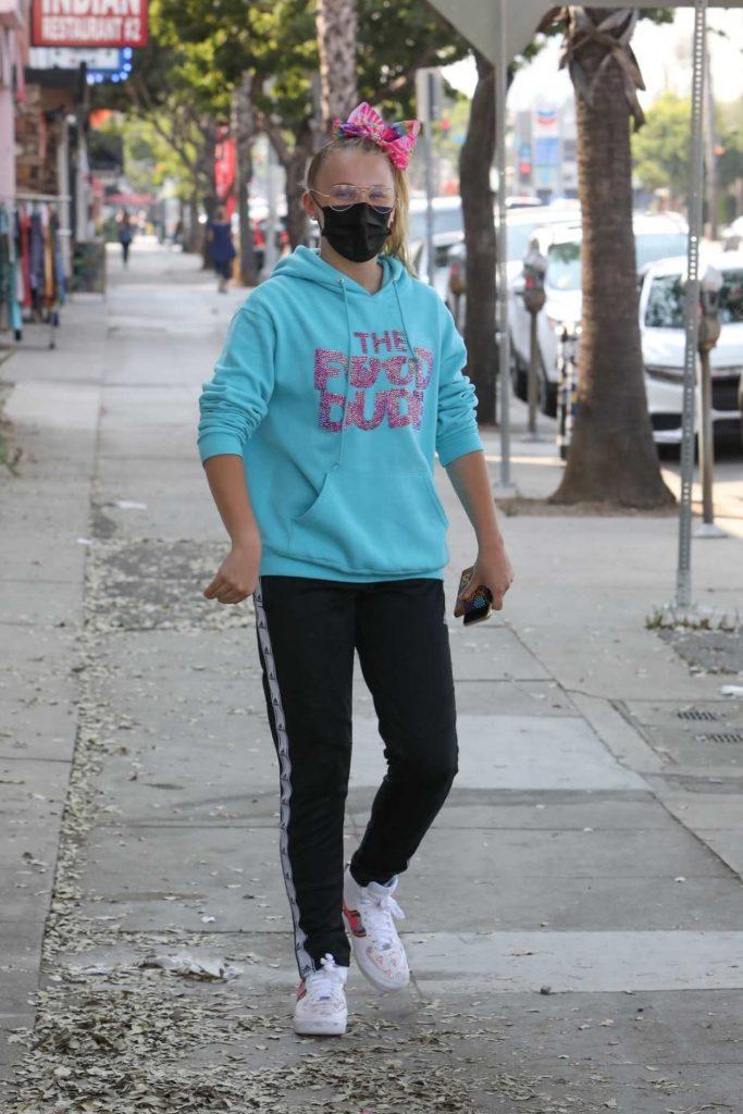 JoJo Siwa in a Black Protective Mask