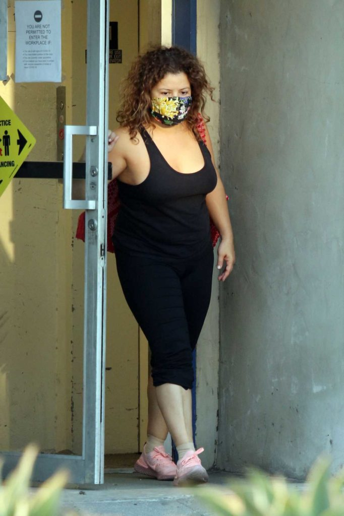 Justina Machado in a Black Tank Top