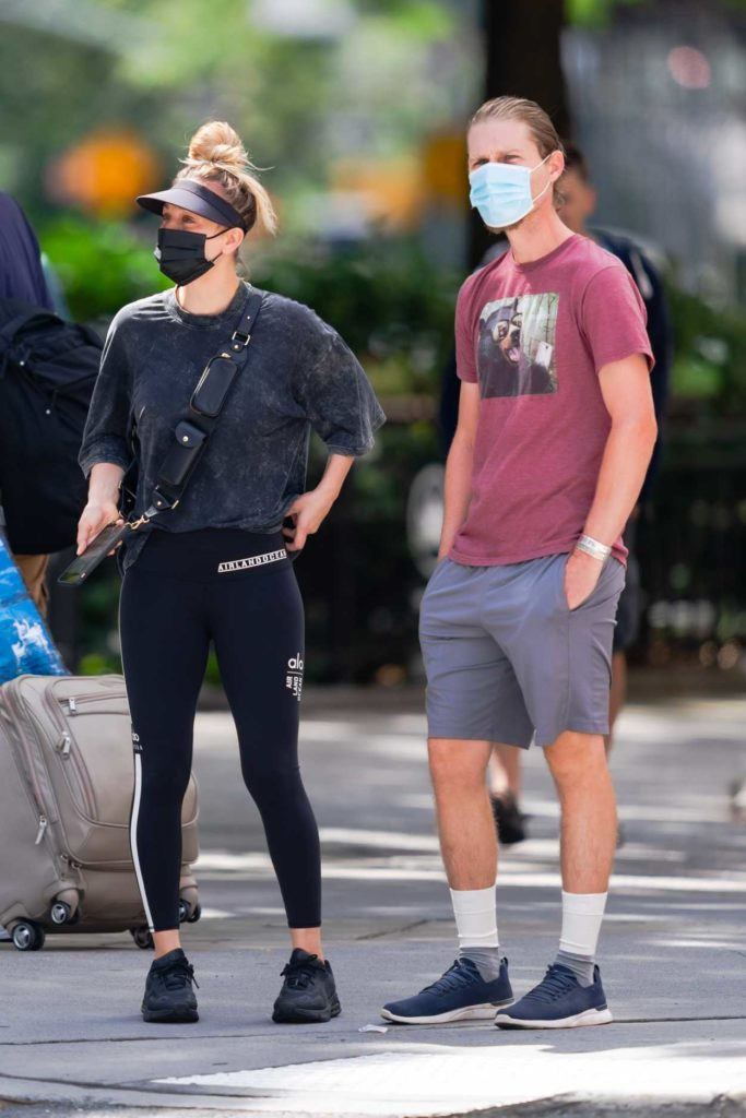 Kaley Cuoco in a Black Sneakers