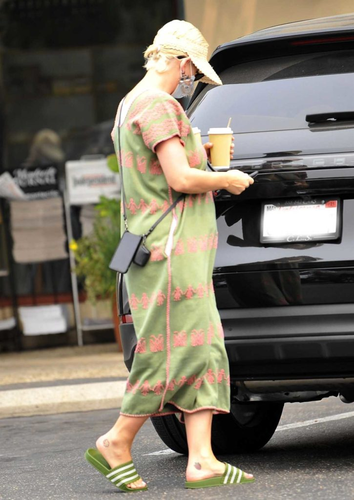 Katy Perry in an Olive Dress