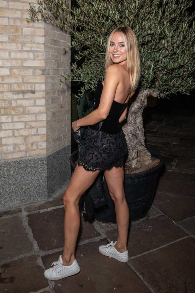 Kimberley Garner in a Black Mini Skirt
