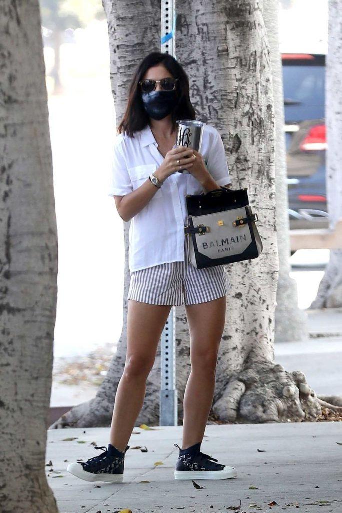 Lucy Hale in a Striped Shorts