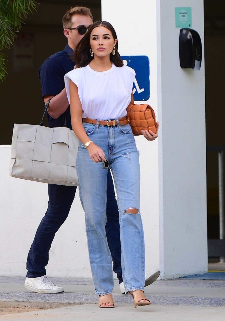 Olivia Culpo in a Blue Ripped Jeans