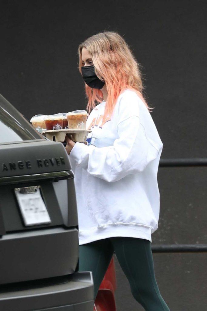 Ashley Benson in a White Sweatshirt