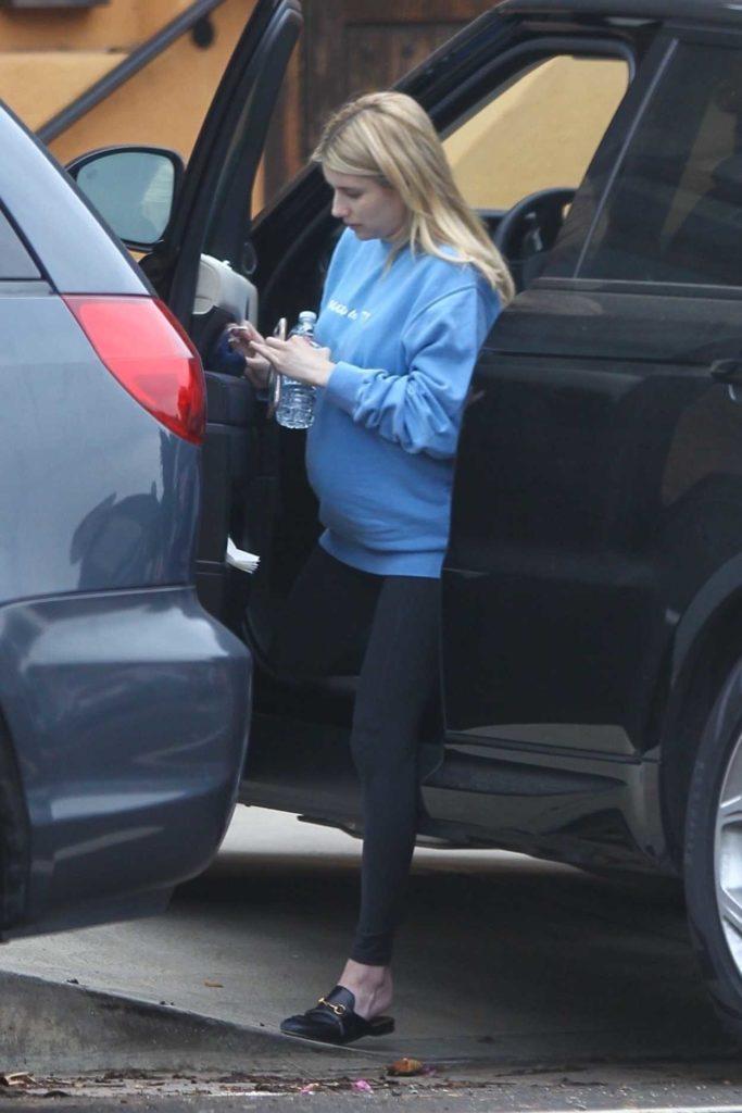 Emma Roberts in a Light Blue Sweatshirt