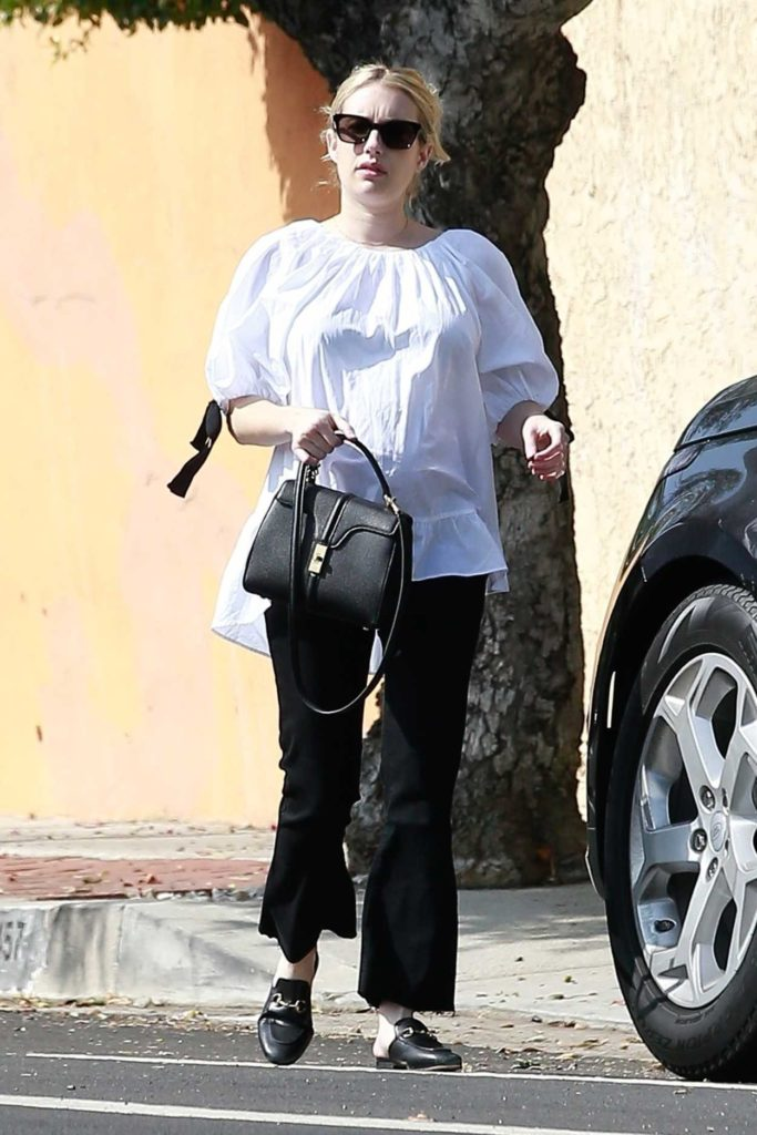 Emma Roberts in a White Blouse