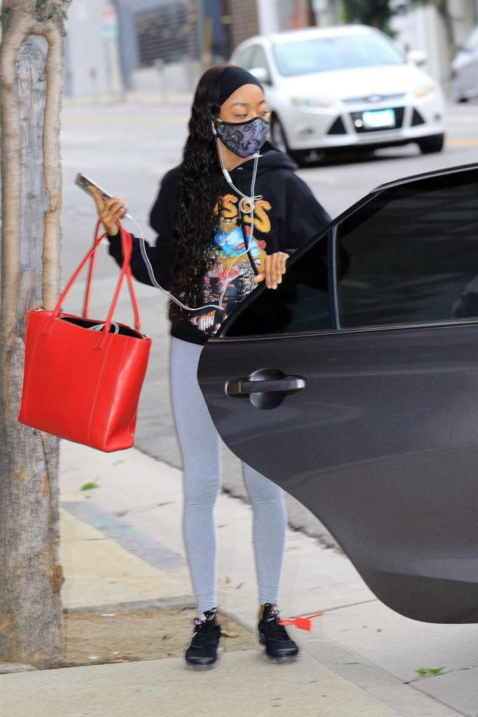 Skai Jackson in a Grey Leggings