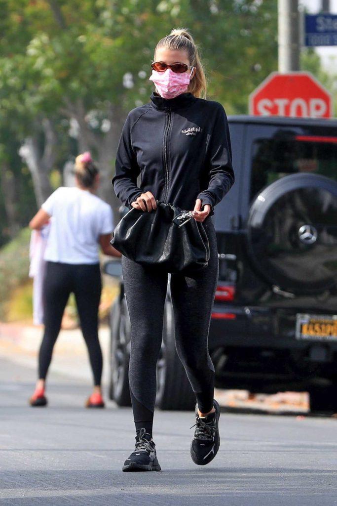 Sofia Richie in a Black Leggings