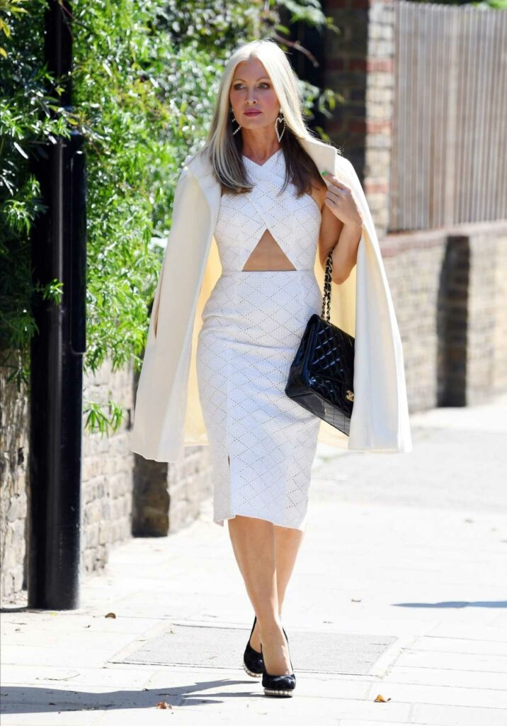 Caprice Bourret in a White Fitted Dress