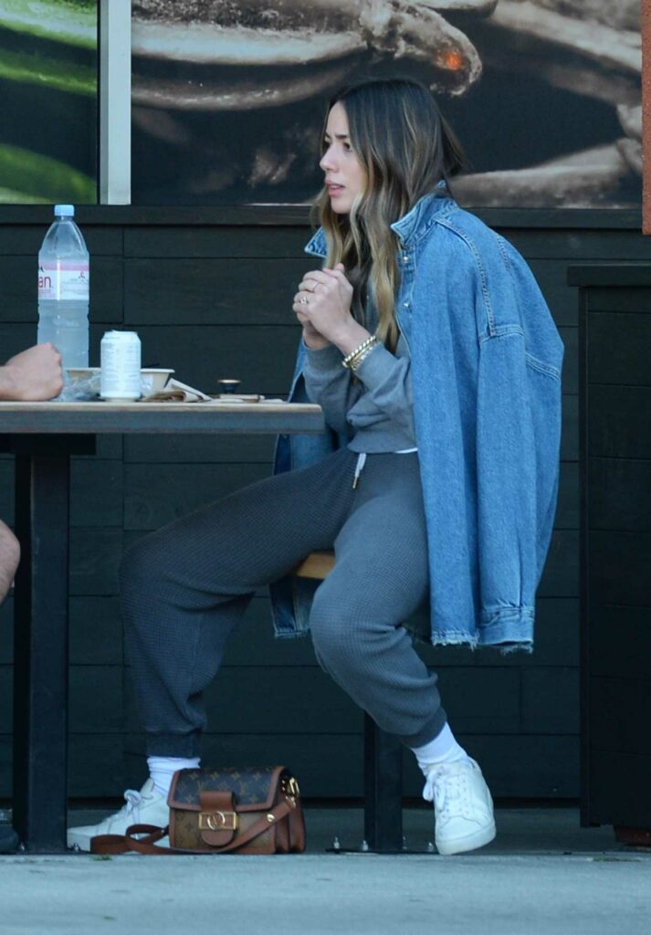 Chloe Bennet in a Blue Denim Jacket