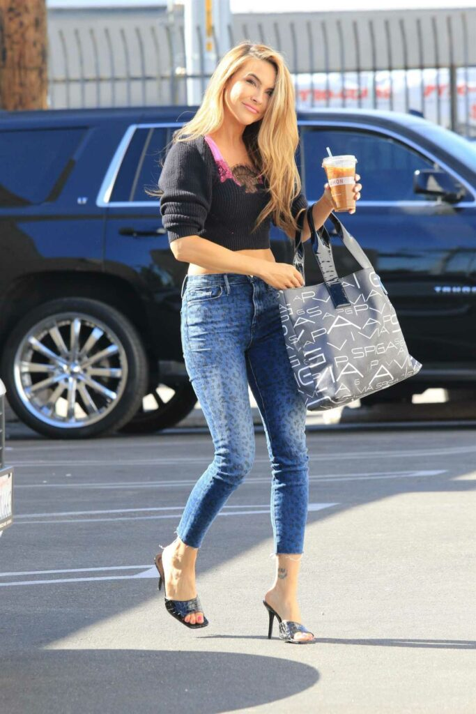 Chrishell Stause in a Blue Animal Print Jeans