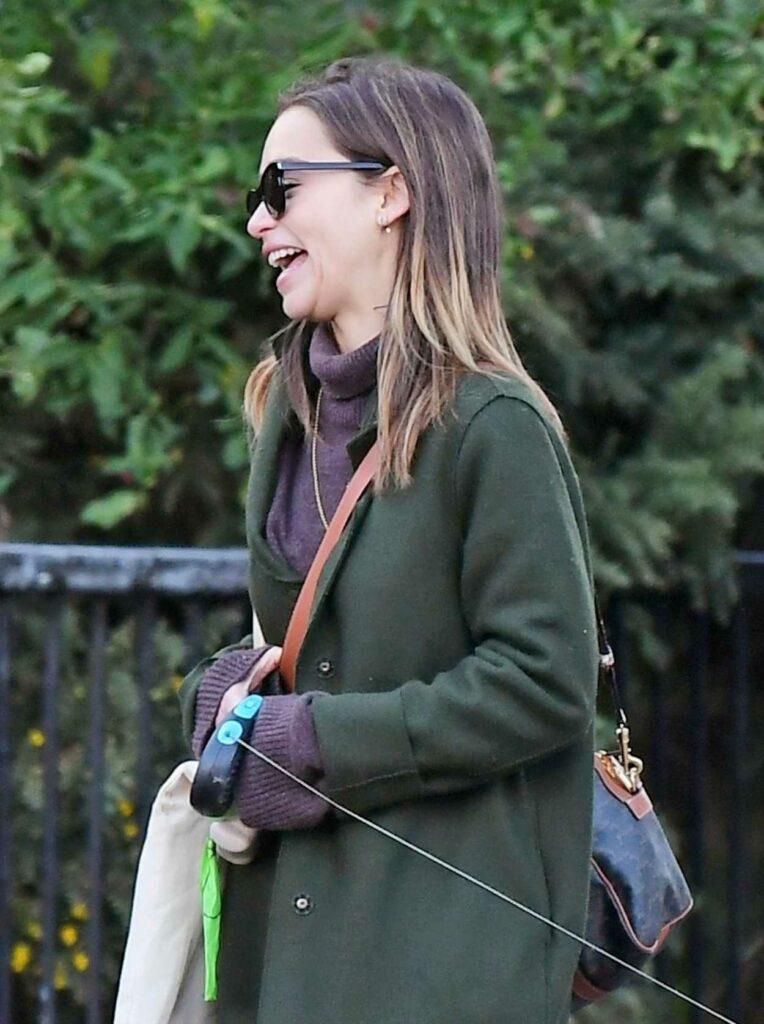 Emilia Clarke in a Green Coat