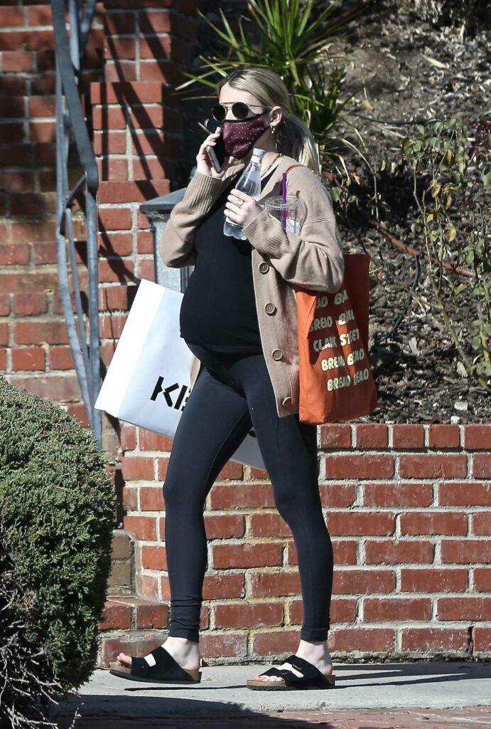 Emma Roberts in a Black Flip-Flops