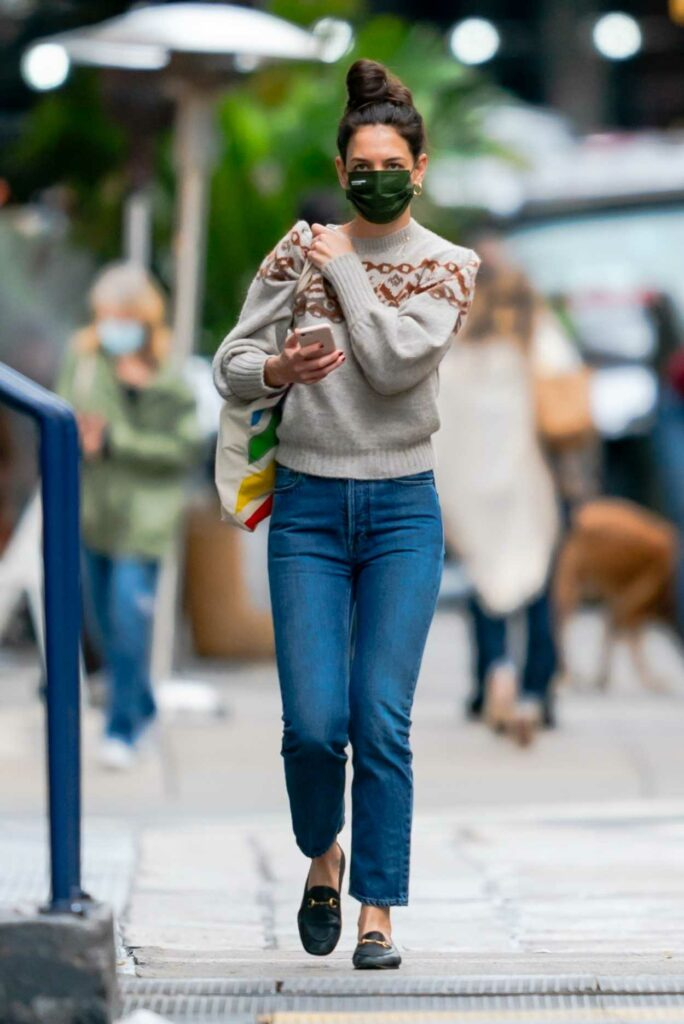 Katie Holmes in a Green Protective Mask