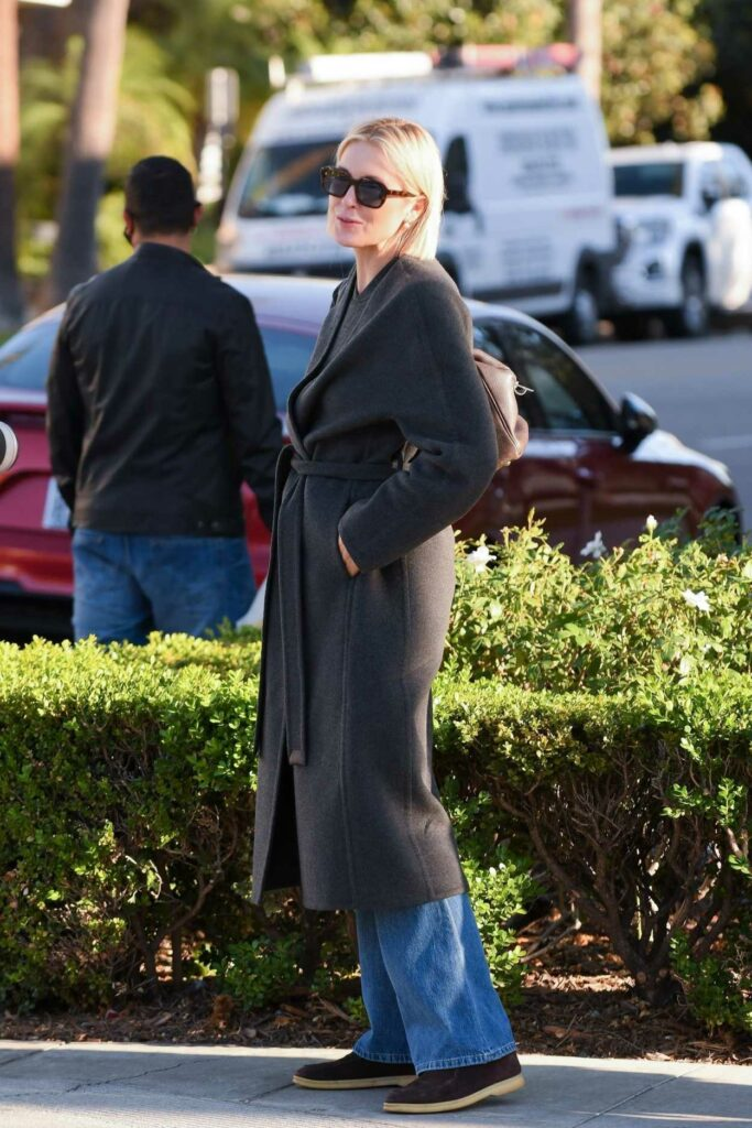Kelly Rutherford in a Black Coat