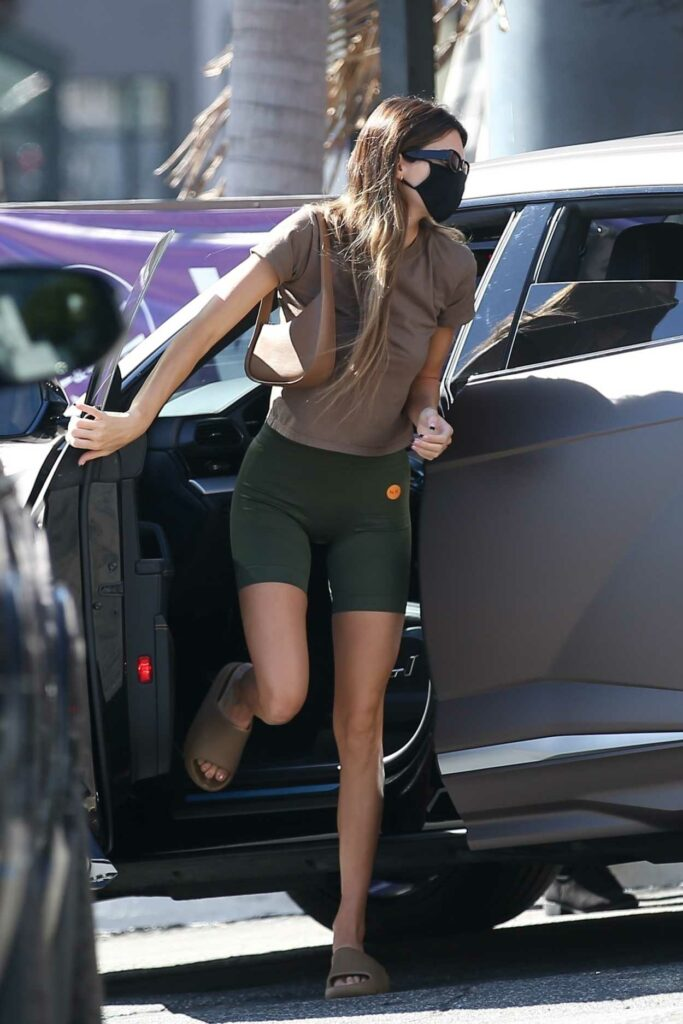 Kendall Jenner in a Green Spandex Shorts