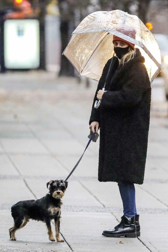 Lili Reinhart in a Black Faux Fur Coat