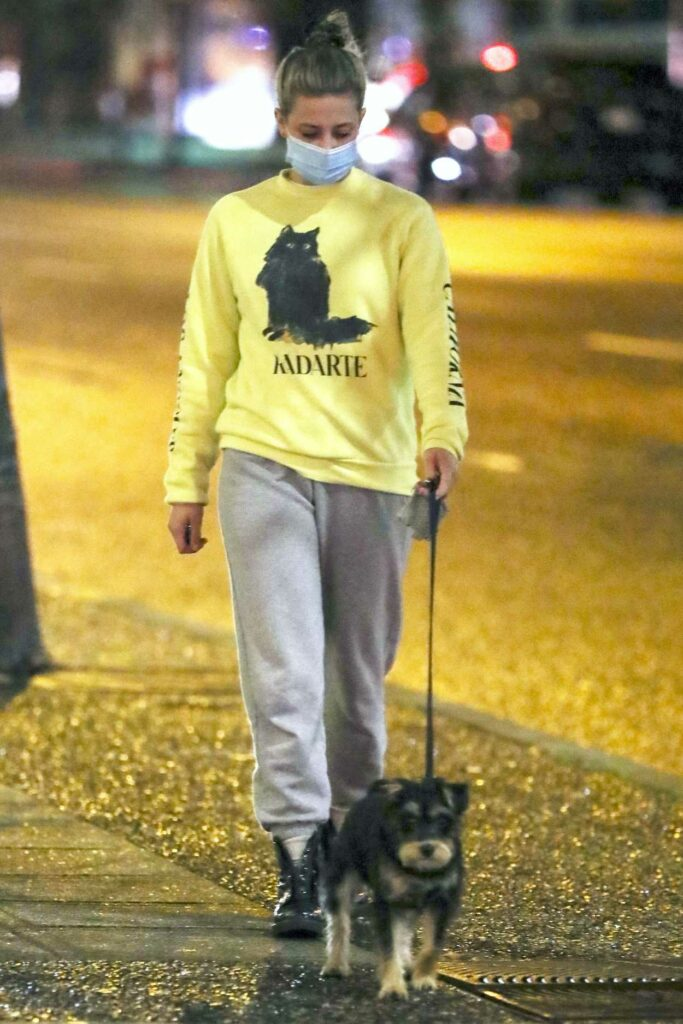 Lili Reinhart in a Yellow Sweatshirt