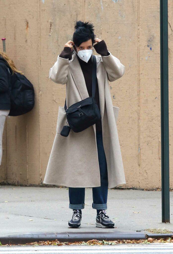 Lily Allen in a Beige Coat