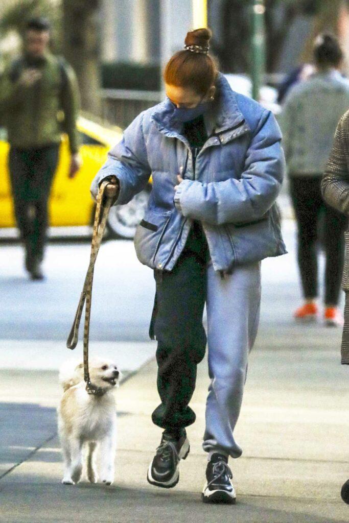 Madelaine Petsch in a Blue Puffer Jacket