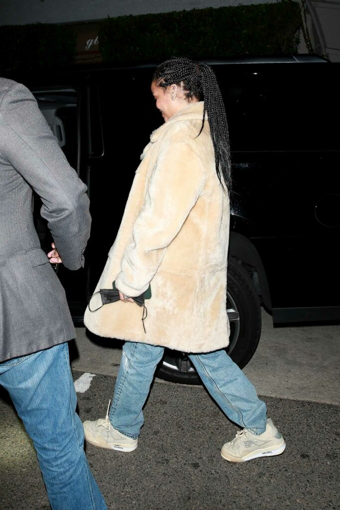 Rihanna in a Blue Ripped Jeans