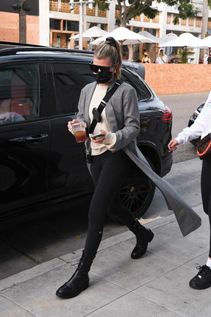 Sofia Richie in a Grey Trench Coat