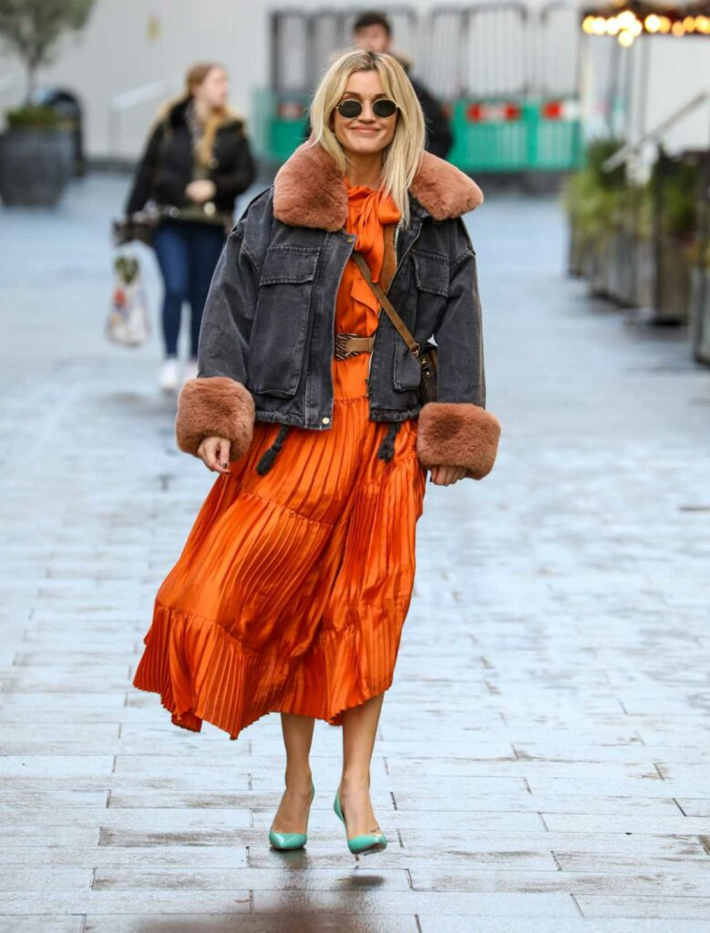 Ashley Roberts in an Orange Dress