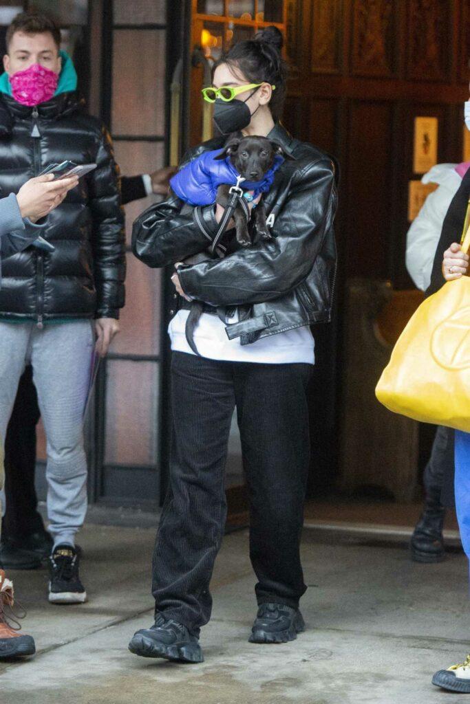 Dua Lipa in a Black Protective Mask