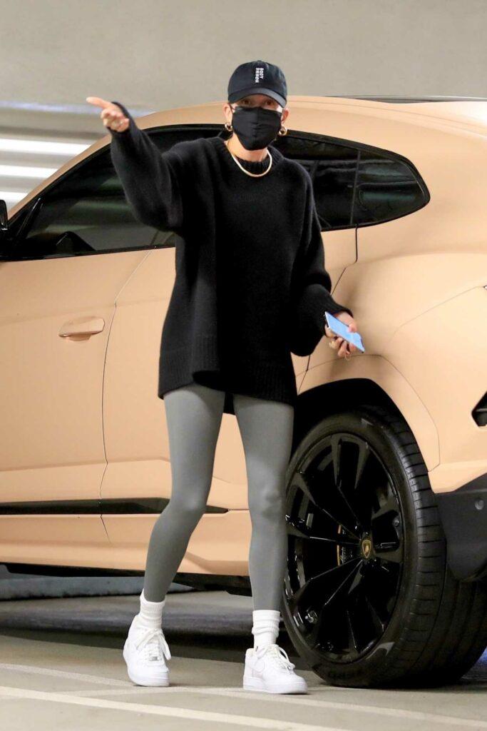 Hailey Bieber in a Black Cap