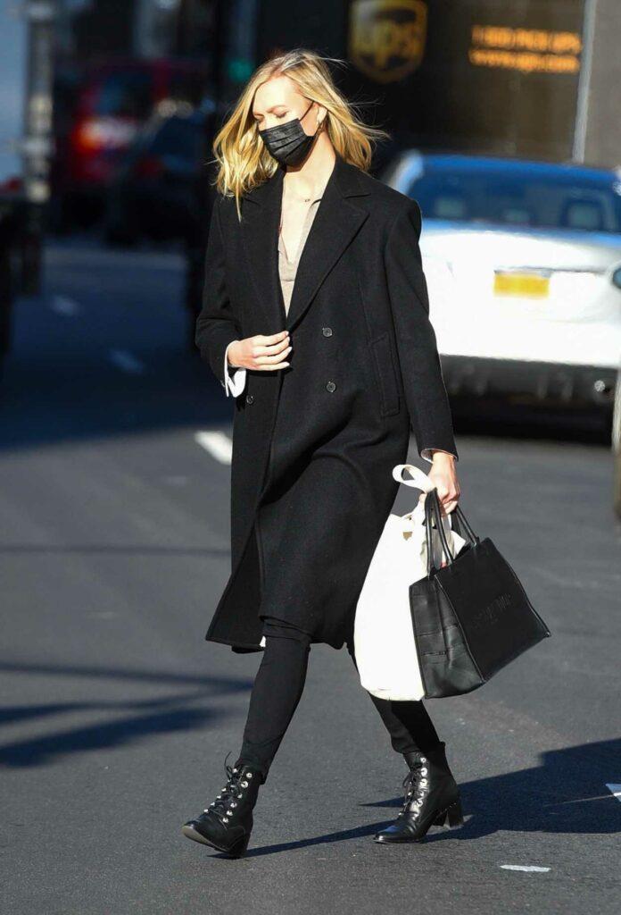 Karlie Kloss in a Black Coat