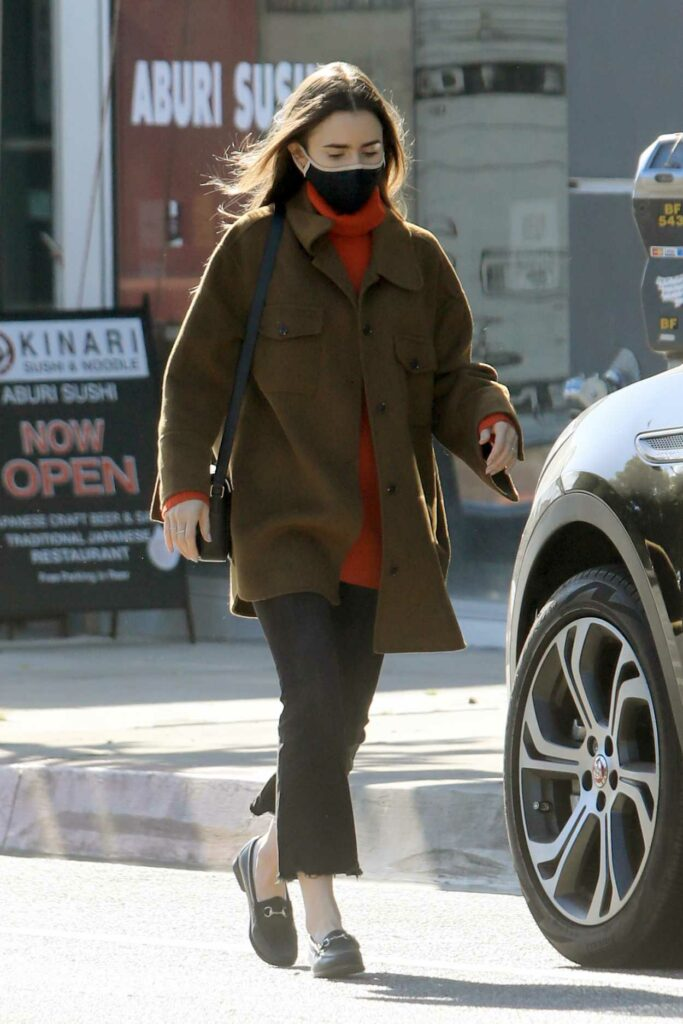 Lily Collins in a Black Protective Mask