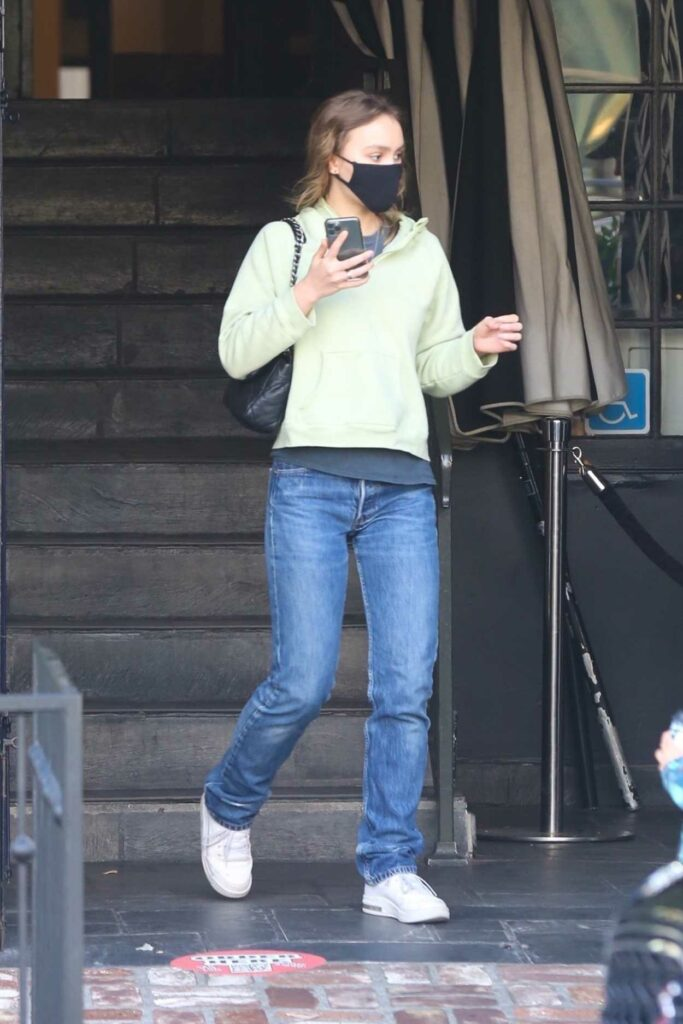 Lily-Rose Depp in a White Sneakers