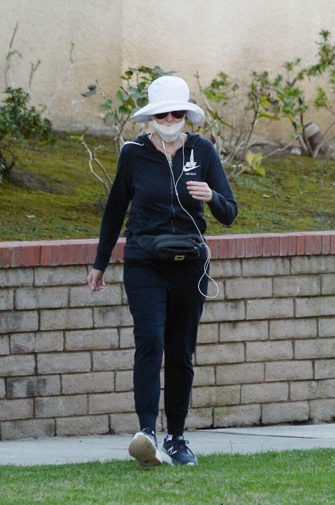 Marcia Cross in a Blue Nike Tracksuit
