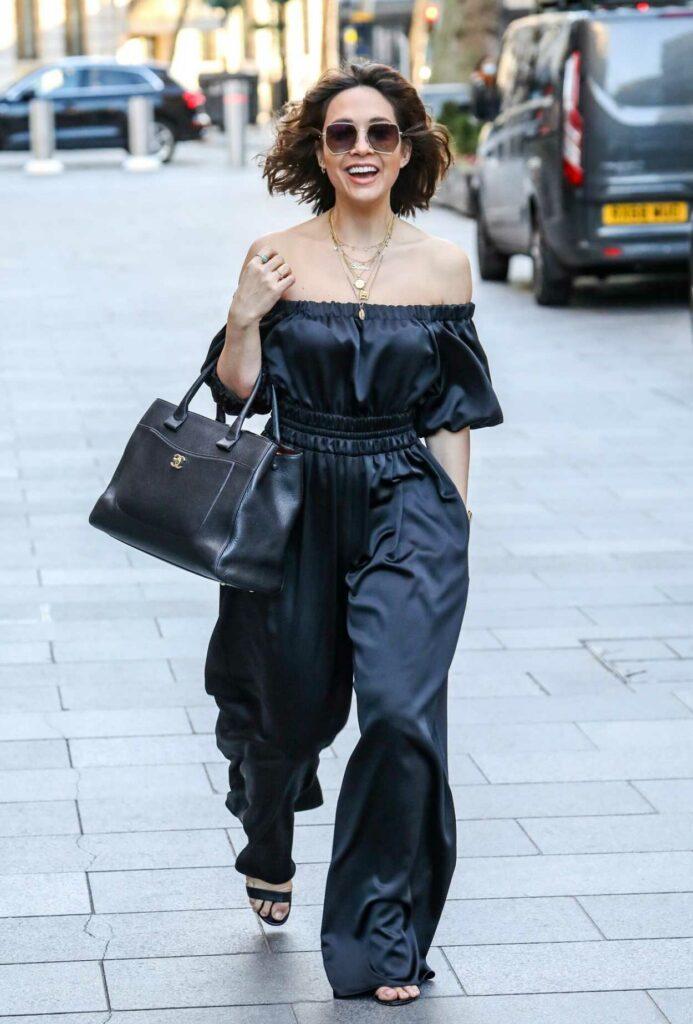 Myleene Klass in a Black Outfit