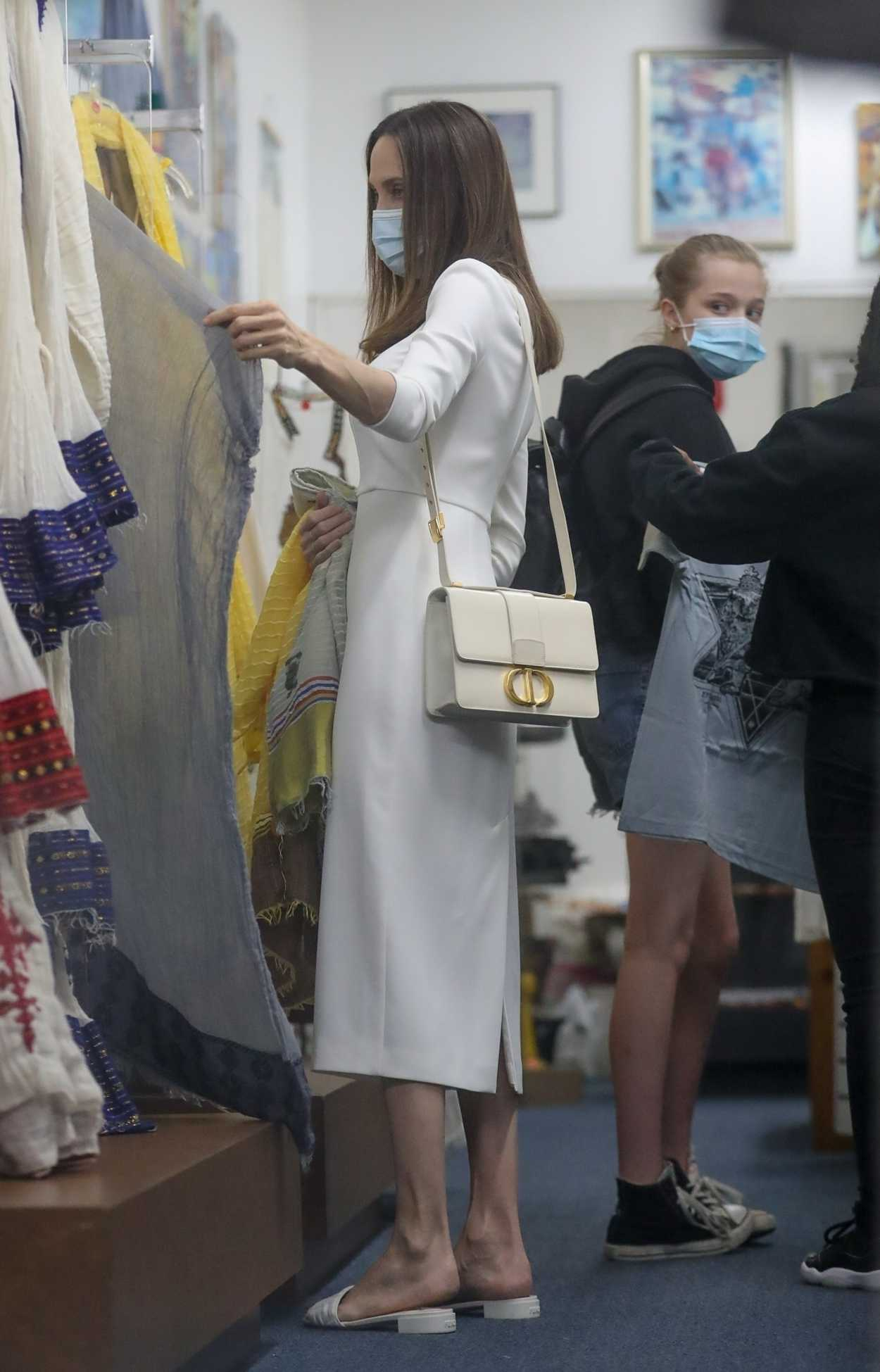 Angelina Jolie in a White Dress Goes Shopping at Ethiopian ...