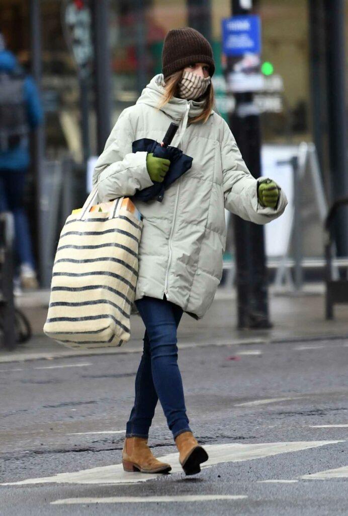 Emilia Clarke in a Brown Beanie Hat