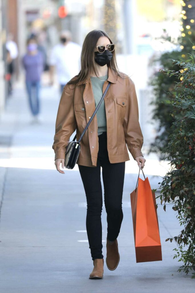 Lily Collins in a Tan Leather Jacket