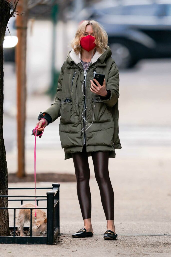 Naomi Watts in a Red Protective Mask