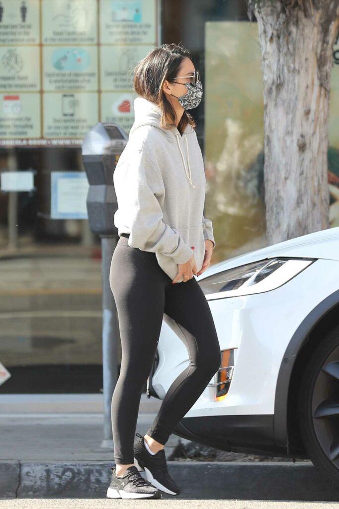 Olivia Munn in a Black Leggings