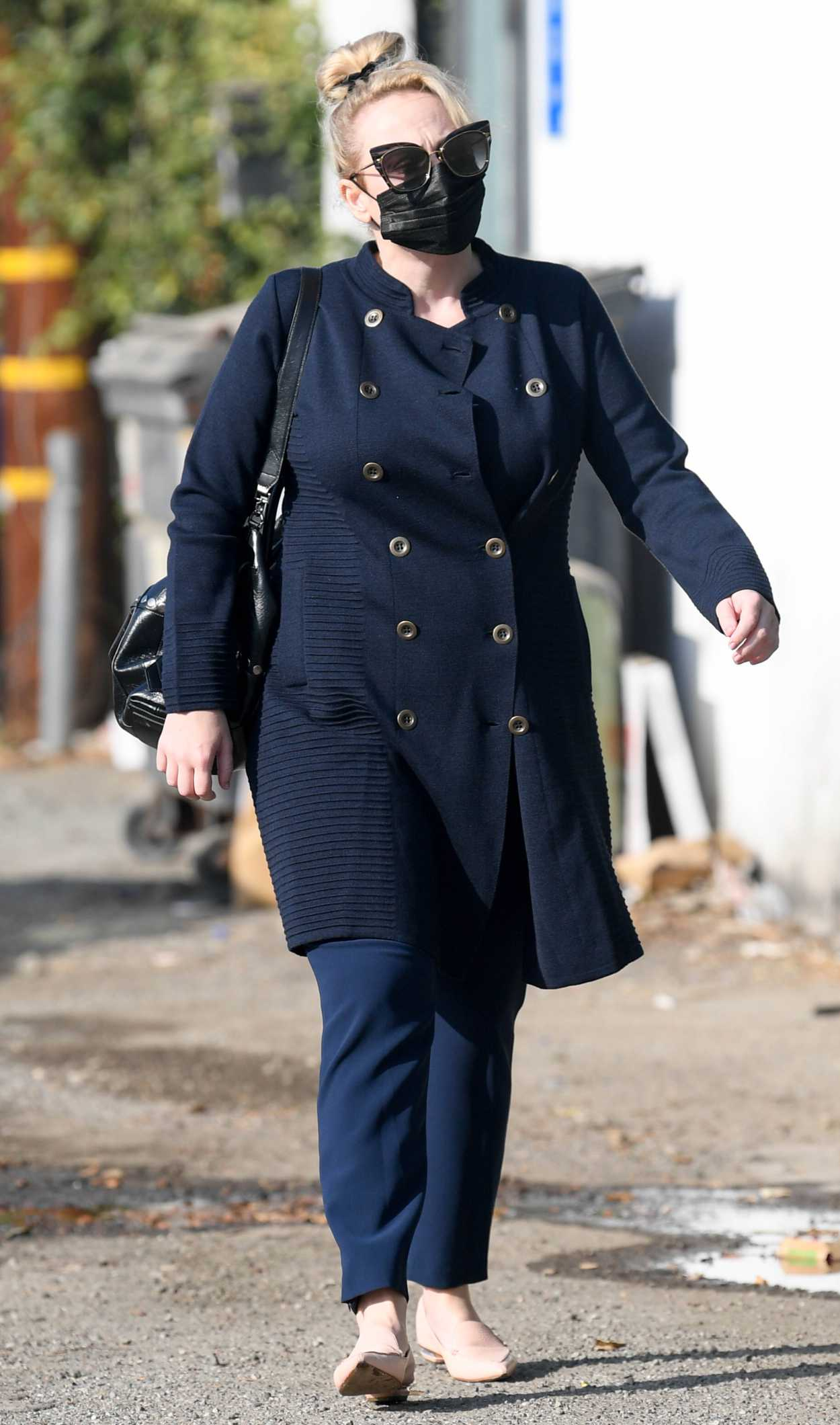 Rebel Wilson in a Black Protective Mask Arrives at a Hair ...