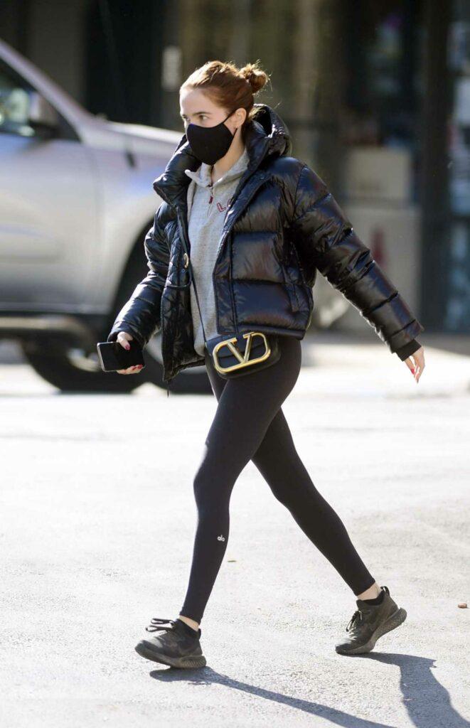 Zoey Deutch in a Black Puffer Jacket