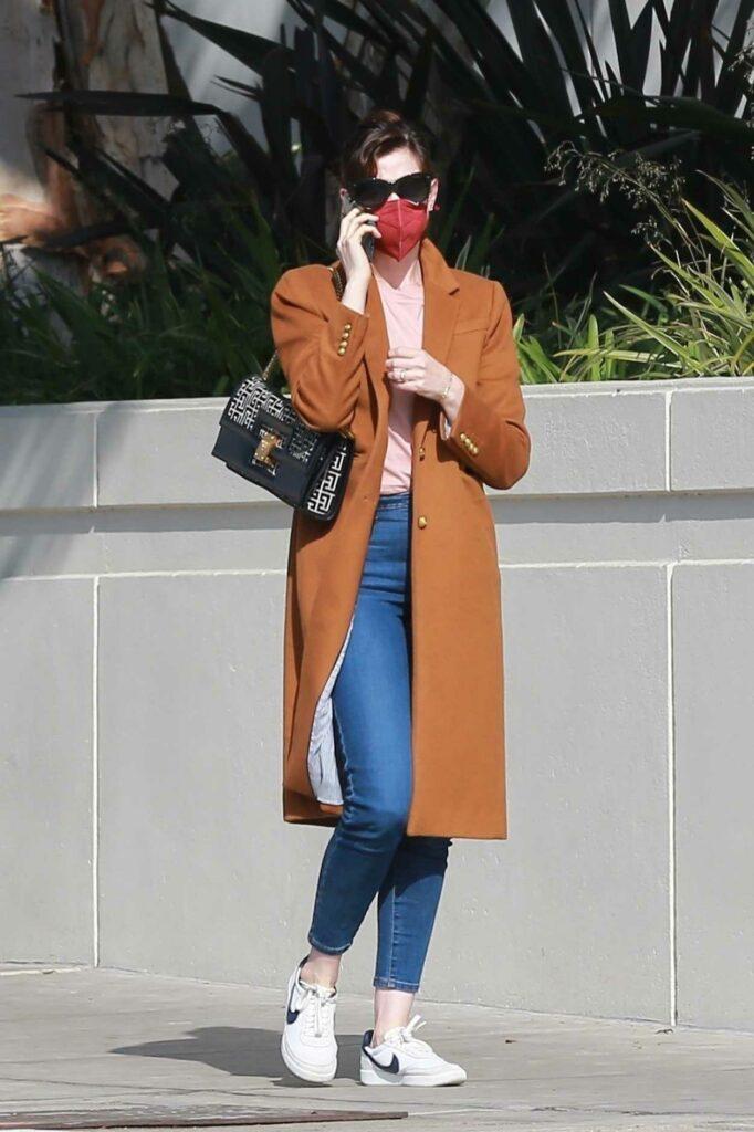 Anne Hathaway in a Tan Coat